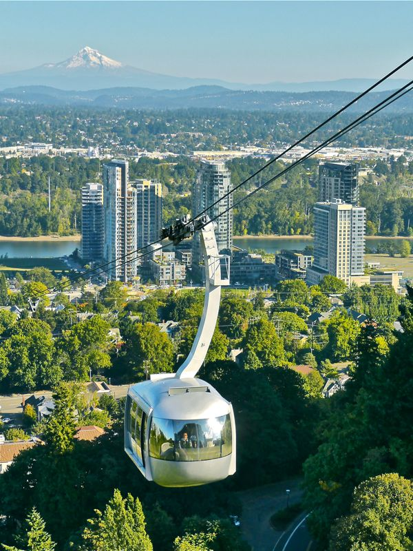Tram descending from OHSU with Mt. Hood in background